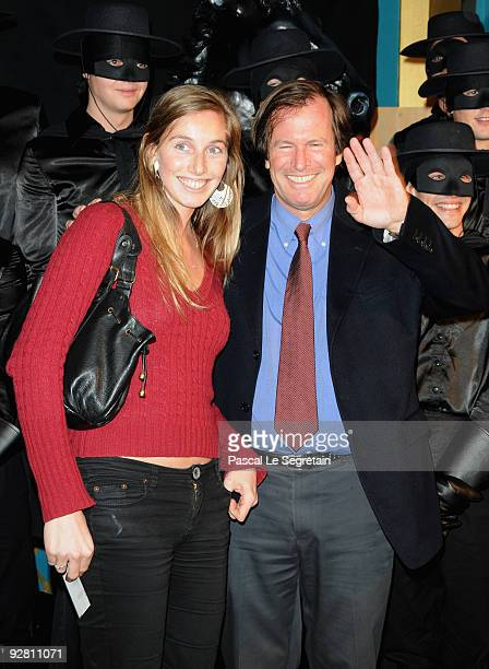 Hubert Auriol and wife attend the Zoro Gala Premiere at Folies Bergeres on November 5 2009 in Paris France