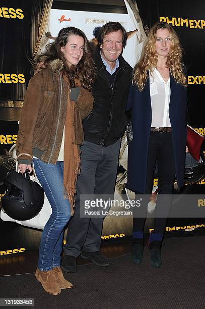 Hubert Auriol with daughters Jenna and Leslie attend the 'Rhum Express' Paris Premiere at Cinema Gaumont Marignan on November 8 2011 in Paris France
