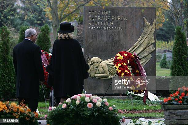 Hubert Burda and his wife Maria Furtwangler look at the Burda's family grave after the funeral service for Aenne Burda on November 10 2005 in...