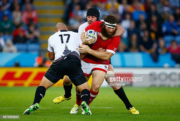 Hubert Buydens of Canada is tackled by Valentin Poparlan and Andrei Ursache of Romania during the 2015 Rugby World Cup Pool D match between Canada...