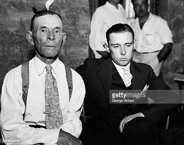 Hubert Dillinger a half brother and John Wilson Dillinger father of John Dillinger are shown in Chicago to claim the body of the dead outlaw