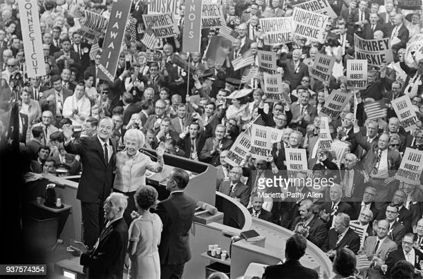 Chicago Illinois August 29 1968 Hubert H Humphrey and Muriel Humphrey wave at the podium of the Democratic National Convention in the International...