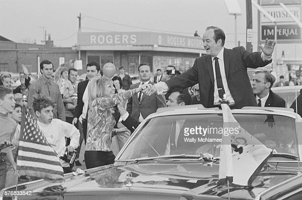 Hubert Humphrey interacts with his supporters from a convertible as it moves down a street in New York City during his 1968 presidential campaign An...
