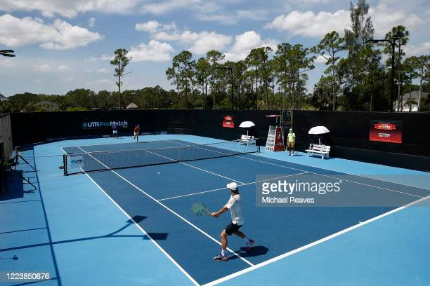 Hubert Hurkacz of Poland and Miomir Kecmanovic of Serbia warm up prior to the UTR Pro Match Series Day 2 on May 09, 2020 in West Palm Beach, Florida.
