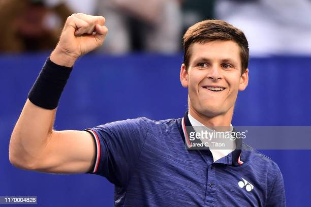 Hubert Hurkacz of Poland celebrates defeating Benoit Paire of France during the men's singles championship final on day eight of the WinstonSalem...