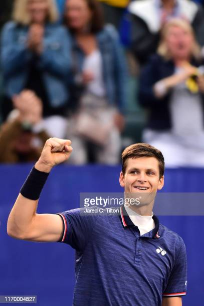 Hubert Hurkacz of Poland celebrates defeating Benoit Paire of France during the men's singles championship final on day eight of the Winston-Salem...