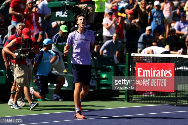 Hubert Hurkacz of Poland celebrates his men's singles fourth round match victory against Denis Shapovalov of Canada on Day 10 of the BNP Paribas Open...