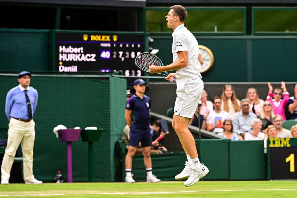Hubert Hurkacz of Poland celebrates his victory over Daniil Medvedev of Russia in the fourth round of the gentlemen's singles during Day Eight of The...