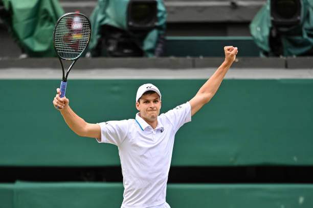 Hubert Hurkacz of Poland celebrates his victory over Roger Federer of Switzerland in the quarter finals of the gentlemen's singles during Day Nine of...