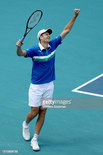 Hubert Hurkacz of Poland celebrates match point against Jannik Sinner of Italy during the final of the Miami Open at Hard Rock Stadium on April 04,...