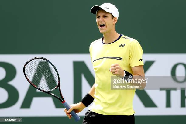 Hubert Hurkacz of Poland celebrates while playing Kei Nishikori of Japan during the BNP Paribas Open at the Indian Wells Tennis Garden on March 12...
