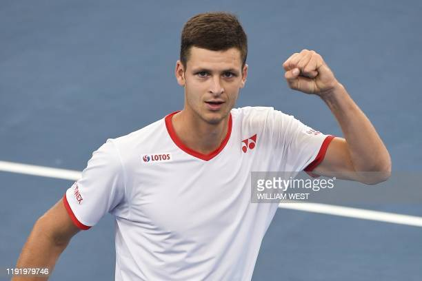 Hubert Hurkacz of Poland celebrates winning against Borna Coric of Croatia in his men's singles match at the ATP Cup tennis tournament in Sydney on...
