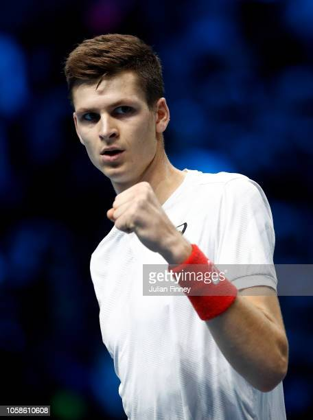 Hubert Hurkacz of Poland celebrates winning at match point in his group match against Jaume Munar of Spain during Day Two of the Next Gen ATP Finals...