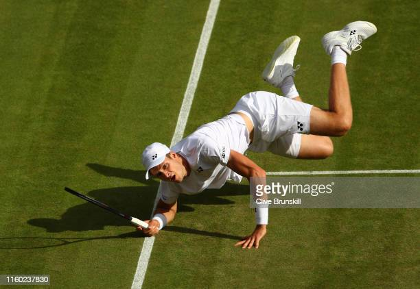 Hubert Hurkacz of Poland dives to return the ball in his Men's Singles third round match against Novak Djokovic of Serbia during Day five of The...