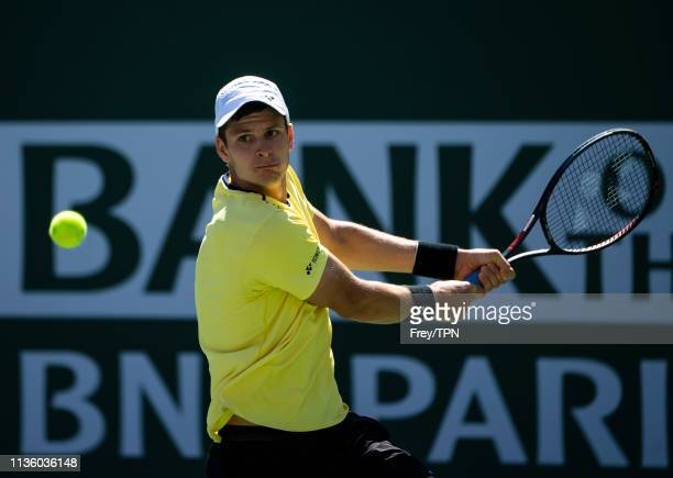 Hubert Hurkacz of Poland hits a backhand against Roger Federer of Switzerland in the quarter finals of the BNP Paribas Open on March 15 2019 at the...
