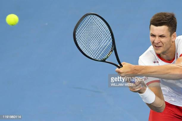 Hubert Hurkacz of Poland hits a backhand return in his men's singles match against Borna Coric of Croatia at the ATP Cup tennis tournament in Sydney...