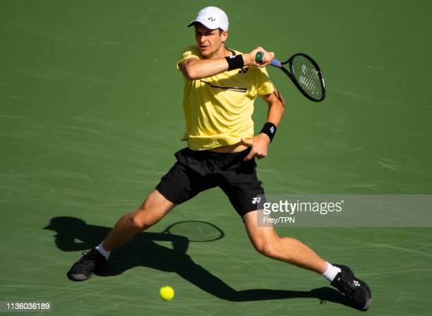 Hubert Hurkacz of Poland hits a forehand against Roger Federer of Switzerland in the quarter finals of the BNP Paribas Open on March 15 2019 at the...