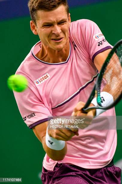 Hubert Hurkacz of Poland hits a return against Zhang Zhizhen of China during their first round men's singles match at the Shanghai Masters tennis...