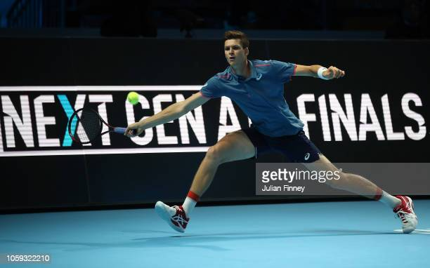 Hubert Hurkacz of Poland in action against Stefanos Tsitsipas of Greece in the group stages during Day Three of the Next Gen ATP Finals at Fiera...