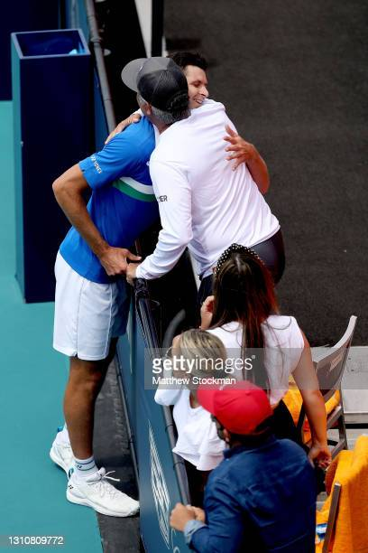 Hubert Hurkacz of Poland is congratulated by his team after defeating Jannik Sinner of Italy during the final of the Miami Open at Hard Rock Stadium...