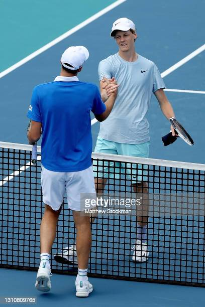 Hubert Hurkacz of Poland is congratulated by Jannik Sinner of Italy during the final of the Miami Open at Hard Rock Stadium on April 04, 2021 in...