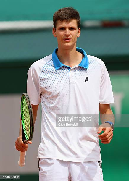 Hubert Hurkacz of Poland looks on in his boy's singles match against Michael Mmoh of the United States on day nine of the 2015 French Open at Roland...