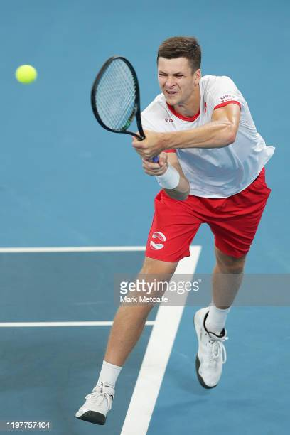 Hubert Hurkacz of Poland plays a backhand during his Group E singles match against Borna Coric of Croatia during day four of the 2020 ATP Cup Group...