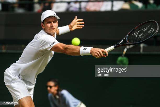 Hubert Hurkacz of Poland plays a backhand in his Men's Singles third round match against Novak Djokovic of Serbia during Day five of The...