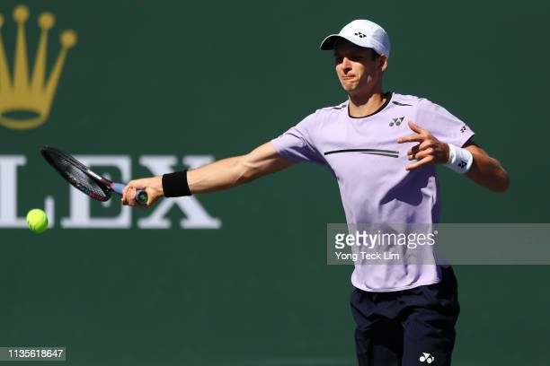 Hubert Hurkacz of Poland plays a forehand against Denis Shapovalov of Canada during their men's singles fourth round match on Day 10 of the BNP...