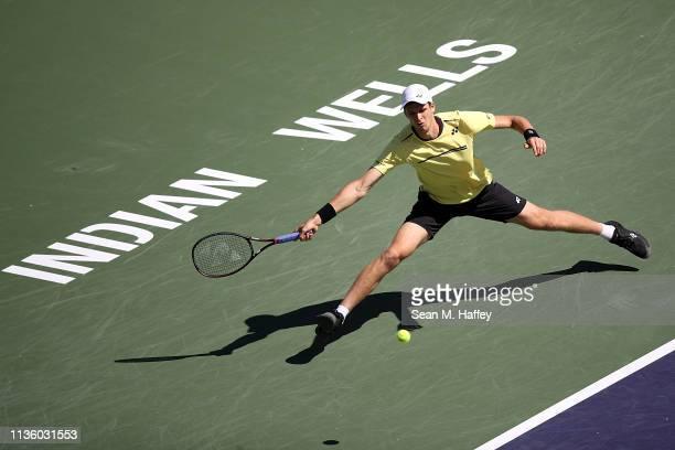 Hubert Hurkacz of Poland plays a forehand against Roger Federer of Switzerland during their men's singles quarterfinal match at the BNP Paribas Open...
