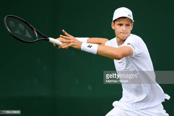 Hubert Hurkacz of Poland plays a forehand in his Men's Singles first round match against Dusan Lajovic of Serbia during Day one of The Championships...