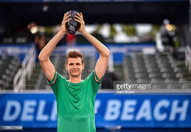 Hubert Hurkacz of Poland poses with the Delray Open Trophy after winning against Sebastian Korda in the Finals of the Delray Beach Open by...