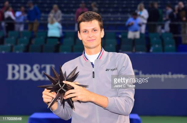 Hubert Hurkacz of Poland poses with the trophy after defeating Benoit Paire of France in the men's singles championship final on day eight of the...
