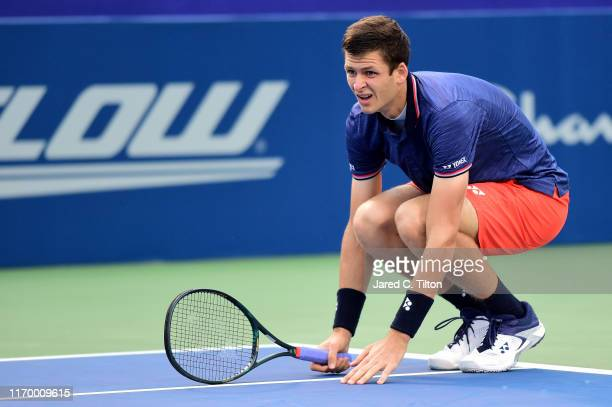 Hubert Hurkacz of Poland reacts following a point against Benoit Paire of France during the men's singles championship final on day eight of the...