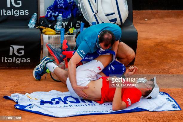 Hubert Hurkacz of Poland receives treatment during his match against Daniel Evans of Britain on day one of the Italian Open at Foro Italico on...