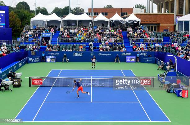 Hubert Hurkacz of Poland returns a shot from Benoit Paire of France during the men's singles championship final on day eight of the Winston-Salem...