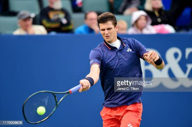 Hubert Hurkacz of Poland returns a shot from Benoit Paire of France during the men's singles championship final on day eight of the WinstonSalem Open...