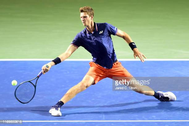 Hubert Hurkacz of Poland returns a shot from Denis Shapovalov of Canada during their semifinals match on day seven of the WinstonSalem Open at Wake...
