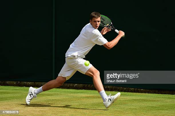Hubert Hurkacz of Poland returns a shot in his Boy's Singles First Round match against Viktor Durasovic of Norway during day seven of the Wimbledon...