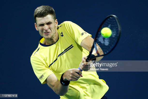 Hubert Hurkacz of Poland returns a shot to Dominic Thiem of Austria during Day 5 of the Miami Open Presented by Itau at Hard Rock Stadium on March 22...