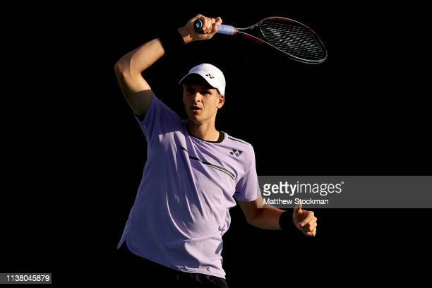 Hubert Hurkacz of Poland returns a shot to Felix AugerAliassine of Canada during the Miami Open Presented by Itau at Hard Rock Stadium March 24 2019...