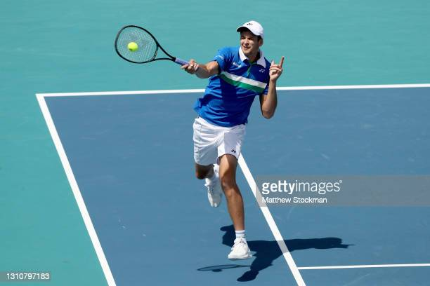 Hubert Hurkacz of Poland returns a shot to Jannik Sinner of Italy during the final of the Miami Open at Hard Rock Stadium on April 04, 2021 in Miami...