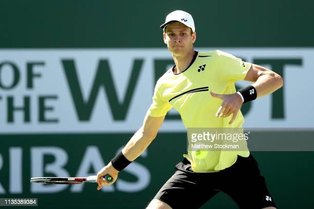Hubert Hurkacz of Poland returns a shot to Kei Nishikori of Japan during the BNP Paribas Open at the Indian Wells Tennis Garden on March 12 2019 in...