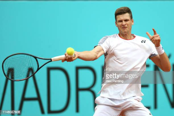 Hubert Hurkacz of Poland returns the bal in his match against Alexander Zverev of Germany during day six of the Mutua Madrid Open at La Caja Magica...