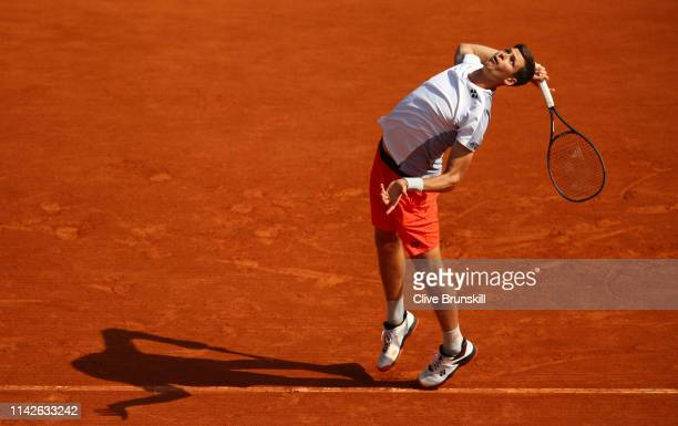 Hubert Hurkacz of Poland serves against Borna Coric of Croatia in their first round match during Day One of the Rolex MonteCarlo Masters at...