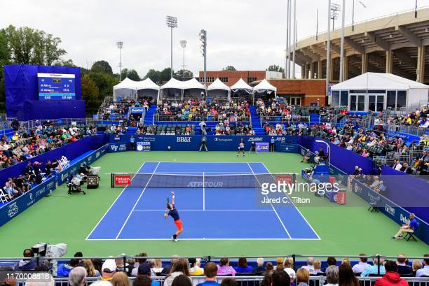 Hubert Hurkacz of Poland serves to Benoit Paire of France during the men's singles championship final on day eight of the Winston-Salem Open at Wake...