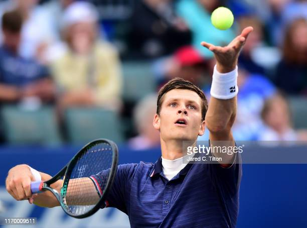 Hubert Hurkacz of Poland serves to Benoit Paire of France during the men's singles championship final on day eight of the WinstonSalem Open at Wake...