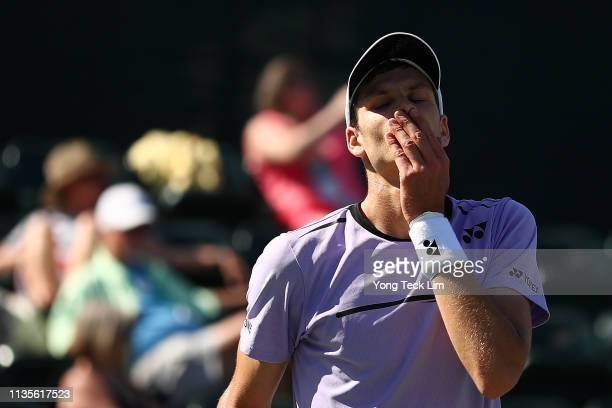 Hubert Hurkacz of Poland shows his frustration during his men's singles fourth round match against Denis Shapovalov of Canada on Day 10 of the BNP...