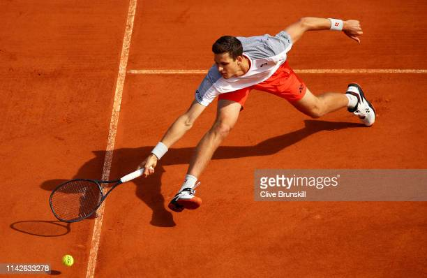 Hubert Hurkacz of Poland stretches to play a forehand volley against Borna Coric of Croatia in their first round match during Day One of the Rolex...