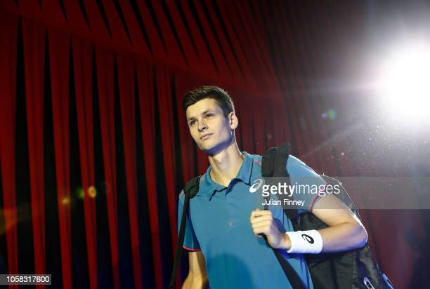 Hubert Hurkacz of Poland walks out into the arena before his match against Frances Tiafoe of USA in the group stages during Day One of the Next Gen...